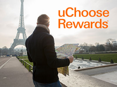 UChoose Rewards Man with a map in Paris image