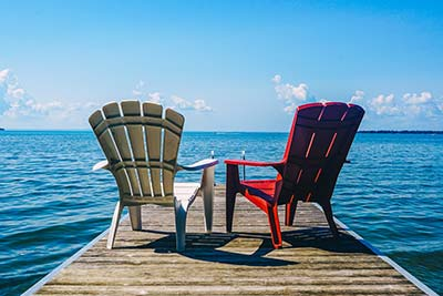 Consumer Credit Card chairs on a ocean dock image
